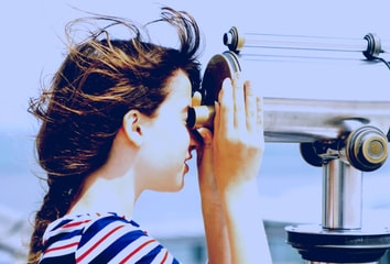 A person looking into a scope, symbolizing monitoring and observation via the Reporting API.