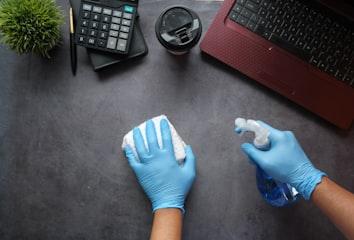 Sanitizing a desk with Sanitizer