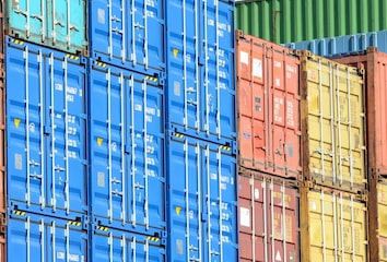 A stack of multicolored shipping containers.