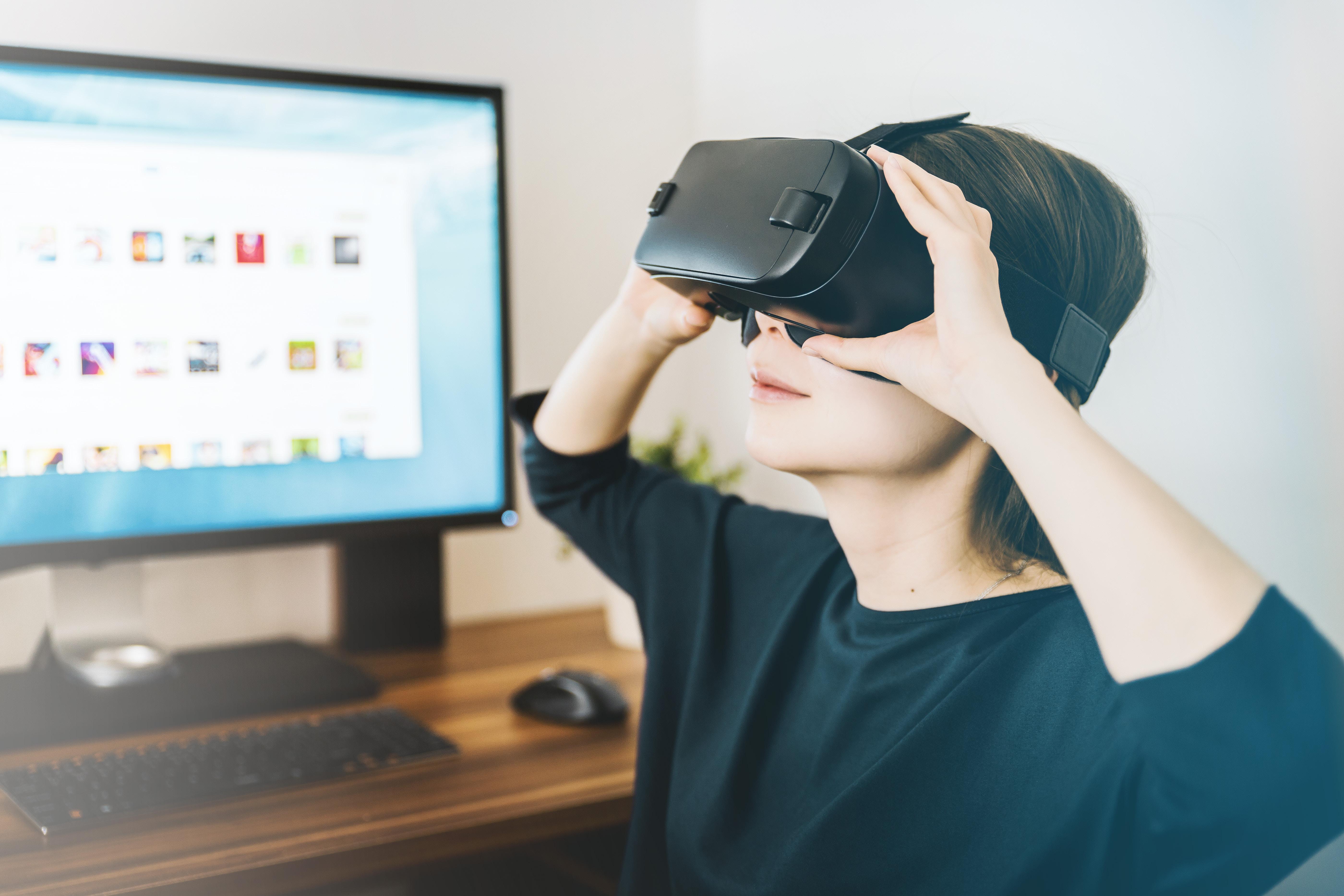 A person using a virtual reality headset.