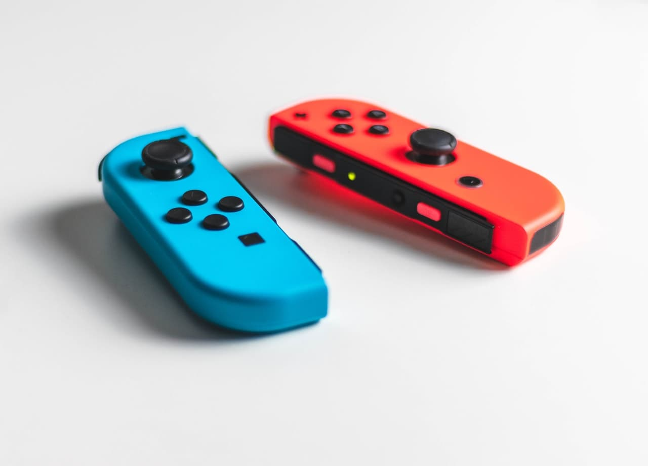 Red and blue nintendo switch photo.