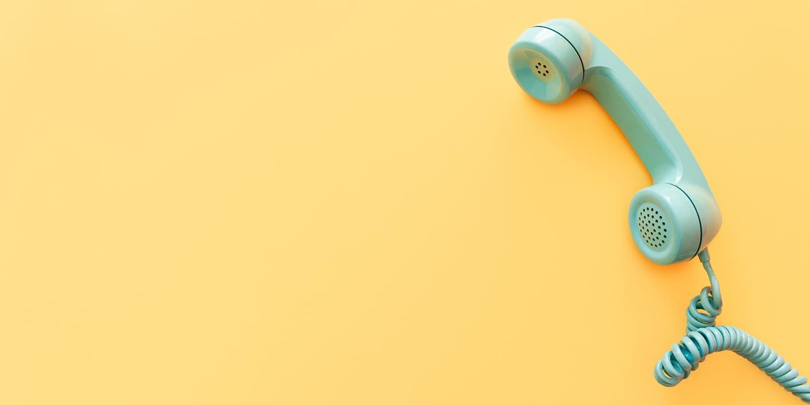 Telephone on yellow background.