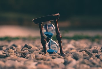 An hourglass with sand pouring through it