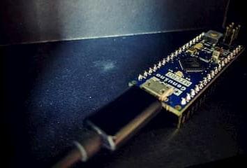 A photo of an Arduino Micro board
