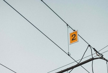 """Overhead power line for a train with a number """"2"""""""