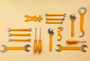 A flatlay photo of wrenches and screwdrivers.