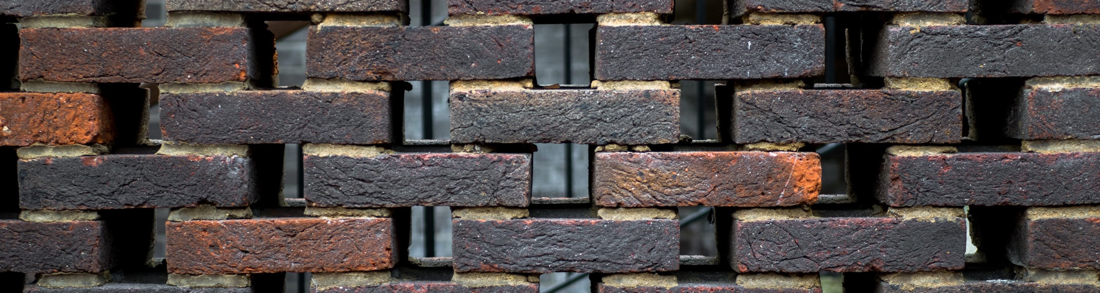 A brick wall with gaps.