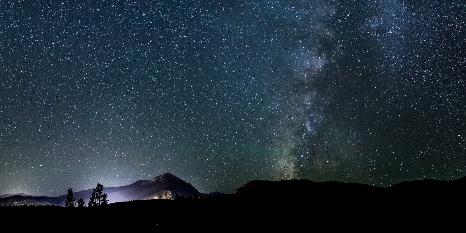 Silhouette photo of a mountain during nighttime, photo by Nathan Anderson on Unsplash.