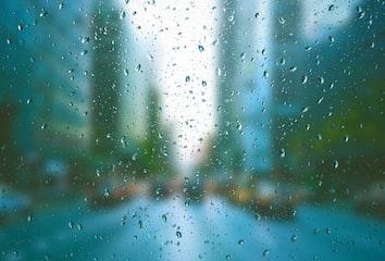 A view through a rain-covered foggy window.