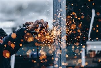 Sparks flying off a metal grinder.