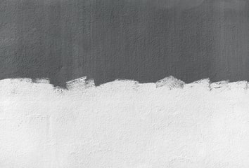 A photograph of a half-painted wall.