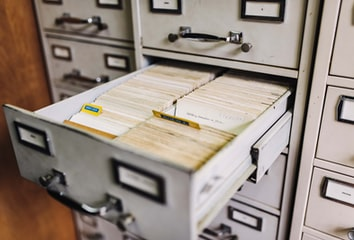 Index cards in a filing cabinet.