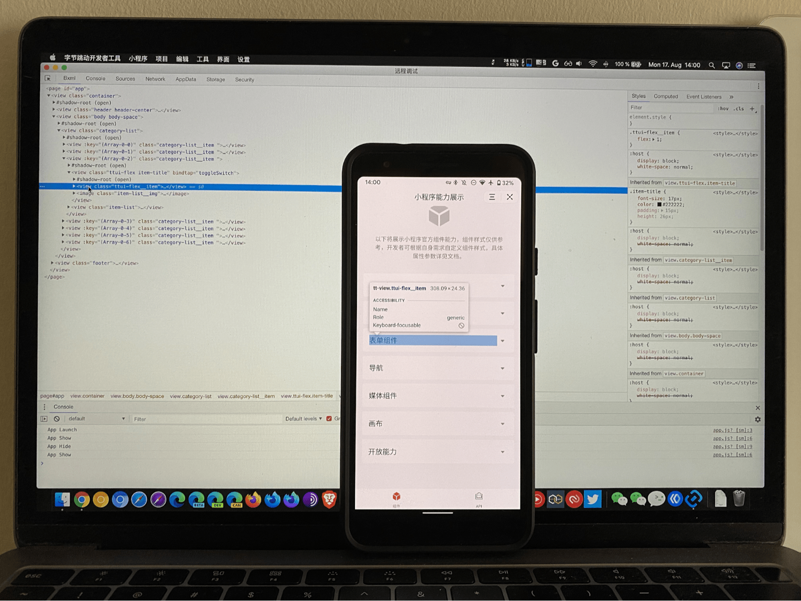A mobile phone running a mini app with parts of the UI highlighted by the ByteDance DevTools debugger running on a laptop inspecting it.