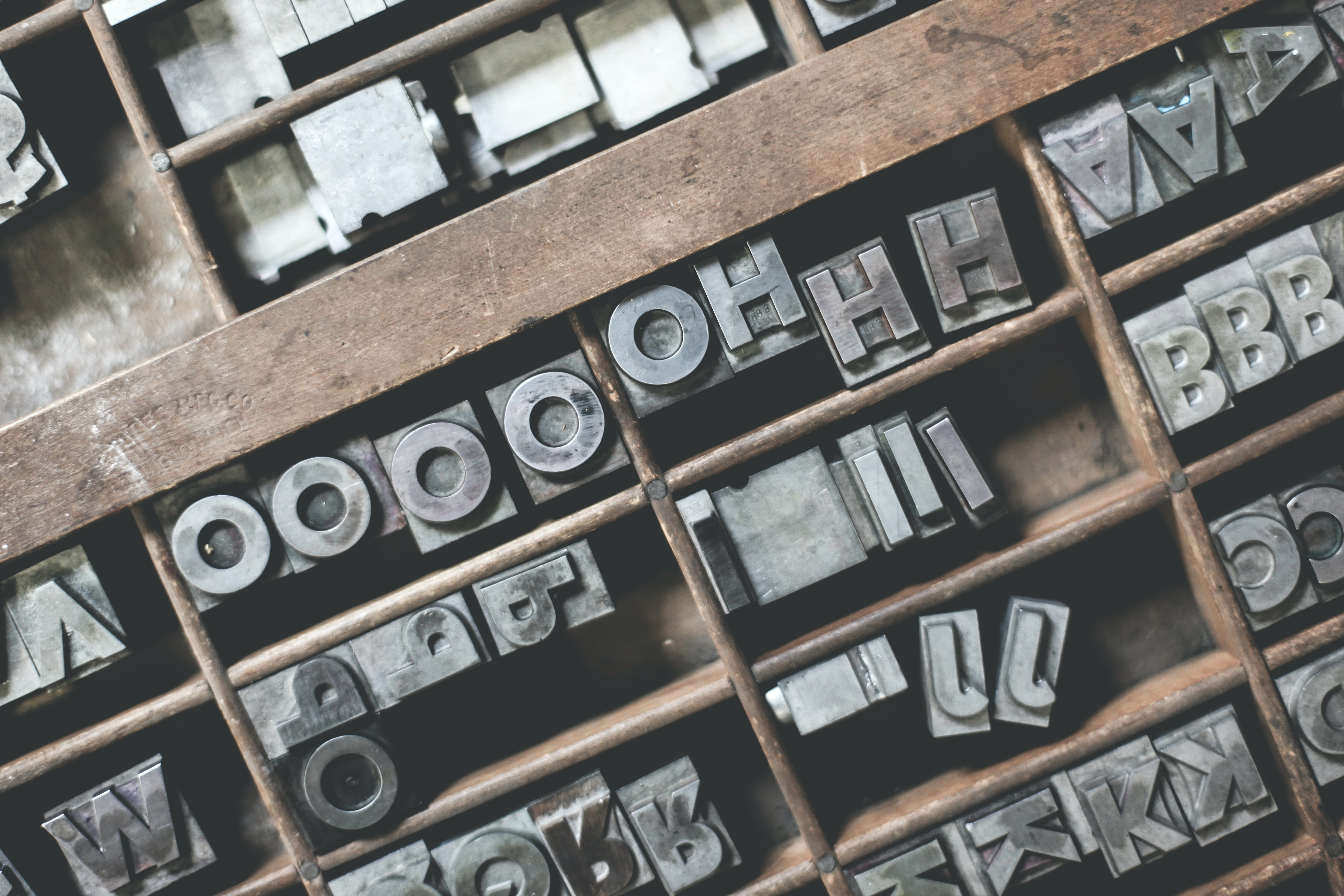 Well used letters from a letterpress, set into rows