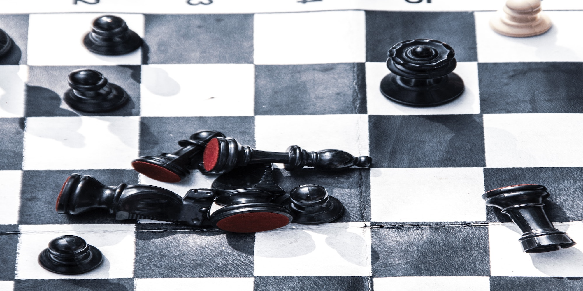 Stretched photo of a chessboard.